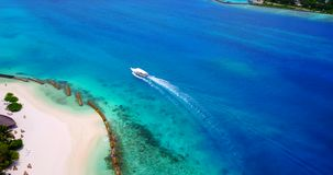 V03220 Aerial flying drone view of Maldives white sandy beach on sunny tropical paradise island with aqua blue sky sea stock footage
