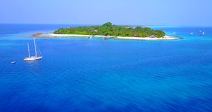 V03376 Aerial flying drone view of Maldives white sandy beach on sunny tropical paradise island with aqua blue sky sea stock footage