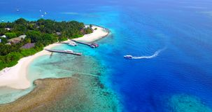 V03446 Aerial flying drone view of Maldives white sandy beach on sunny tropical paradise island with aqua blue sky sea stock footage