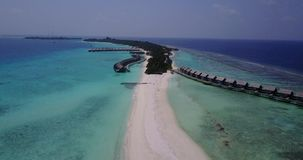 V03638 Aerial flying drone view of Maldives white sandy beach on sunny tropical paradise island with aqua blue sky sea stock video footage