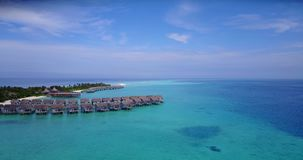 V03642 Aerial flying drone view of Maldives white sandy beach on sunny tropical paradise island with aqua blue sky sea stock video footage