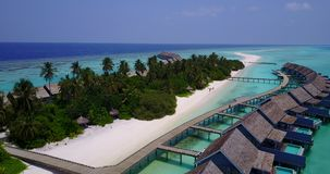 V03662 Aerial flying drone view of Maldives white sandy beach on sunny tropical paradise island with aqua blue sky sea stock footage
