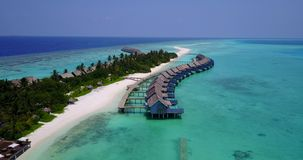 V03722 Aerial flying drone view of Maldives white sandy beach on sunny tropical paradise island with aqua blue sky sea stock video