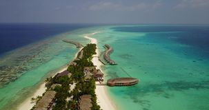 V03716 Aerial flying drone view of Maldives white sandy beach on sunny tropical paradise island with aqua blue sky sea stock footage