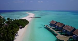V03741 Aerial flying drone view of Maldives white sandy beach on sunny tropical paradise island with aqua blue sky sea stock video footage