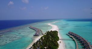V03789 Aerial flying drone view of Maldives white sandy beach on sunny tropical paradise island with aqua blue sky sea stock video
