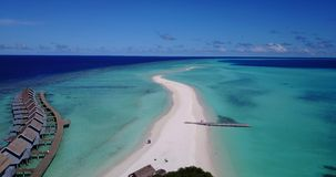 V03774 Aerial flying drone view of Maldives white sandy beach on sunny tropical paradise island with aqua blue sky sea stock footage