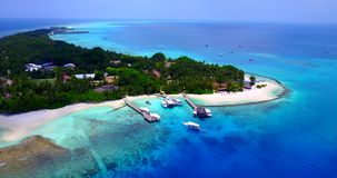 V03029 Aerial flying drone view of Maldives white sandy beach on sunny tropical paradise island with aqua blue sky sea stock video footage