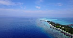 V03620 Aerial flying drone view of Maldives white sandy beach on sunny tropical paradise island with aqua blue sky sea stock video