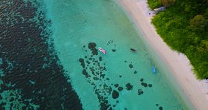 V03521 Aerial flying drone view of Maldives white sandy beach on sunny tropical paradise island with aqua blue sky sea stock video