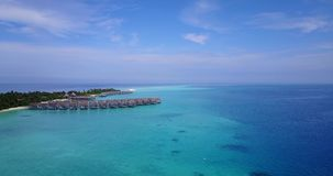 V03531 Aerial flying drone view of Maldives white sandy beach on sunny tropical paradise island with aqua blue sky sea stock video