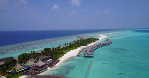 V03541 Aerial flying drone view of Maldives white sandy beach on sunny tropical paradise island with aqua blue sky sea stock video footage