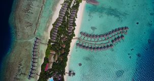 V03592 Aerial flying drone view of Maldives white sandy beach on sunny tropical paradise island with aqua blue sky sea stock video footage