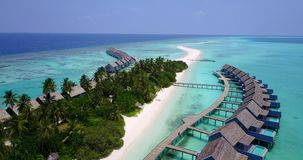 V03611 Aerial flying drone view of Maldives white sandy beach on sunny tropical paradise island with aqua blue sky sea stock video