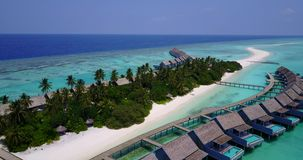 V03673 Aerial flying drone view of Maldives white sandy beach on sunny tropical paradise island with aqua blue sky sea stock video footage