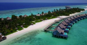 V03682 Aerial flying drone view of Maldives white sandy beach on sunny tropical paradise island with aqua blue sky sea stock footage