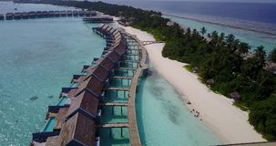 V03792 Aerial flying drone view of Maldives white sandy beach on sunny tropical paradise island with aqua blue sky sea stock footage
