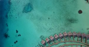 V03802 Aerial flying drone view of Maldives white sandy beach on sunny tropical paradise island with aqua blue sky sea stock video footage