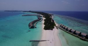 V03604 Aerial flying drone view of Maldives white sandy beach on sunny tropical paradise island with aqua blue sky sea stock video