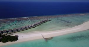 V03549 Aerial flying drone view of Maldives white sandy beach on sunny tropical paradise island with aqua blue sky sea stock video footage