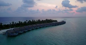 V03680 Aerial flying drone view of Maldives white sandy beach on sunny tropical paradise island with aqua blue sky sea stock video