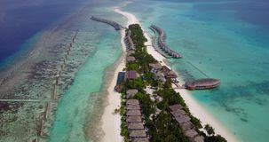 V03628 Aerial flying drone view of Maldives white sandy beach on sunny tropical paradise island with aqua blue sky sea stock footage