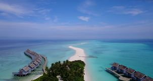 V03782 Aerial flying drone view of Maldives white sandy beach on sunny tropical paradise island with aqua blue sky sea stock video