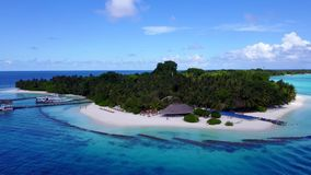 V04531 Aerial flying drone view of Maldives white sandy beach on sunny tropical paradise island with aqua blue sky sea