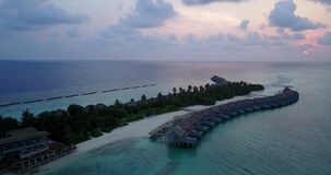V06613 Aerial flying drone view of Maldives white sandy beach sunset sunrise on sunny tropical paradise island with aqua. Aerial flying drone view of Maldives stock video