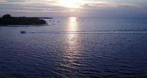 V06573 Aerial flying drone view of Maldives white sandy beach sunset sunrise on sunny tropical paradise island with aqua. Aerial flying drone view of Maldives stock video footage