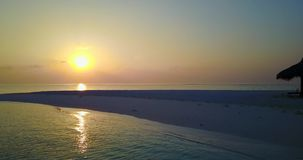V06663 Aerial flying drone view of Maldives white sandy beach sunset sunrise on sunny tropical paradise island with aqua. Aerial flying drone view of Maldives stock video footage