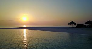 V06495 Aerial flying drone view of Maldives white sandy beach sunset sunrise on sunny tropical paradise island with aqua stock video footage