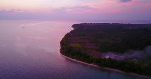 V06517 Aerial flying drone view of Maldives white sandy beach sunset sunrise on sunny tropical paradise island with aqua stock video footage