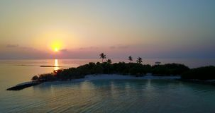 V06650 Aerial flying drone view of Maldives white sandy beach sunset sunrise on sunny tropical paradise island with aqua stock video footage