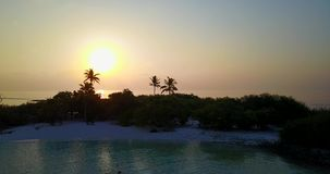 V06485 Aerial flying drone view of Maldives white sandy beach sunset sunrise on sunny tropical paradise island with aqua stock video footage