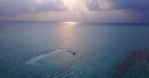 V06583 Aerial flying drone view of Maldives white sandy beach sunset sunrise on sunny tropical paradise island with aqua stock video footage