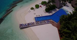 V06748 Aerial flying drone view of Maldives white sandy beach swimming pool in luxury 5 star resort hotel relaxing Stock Image