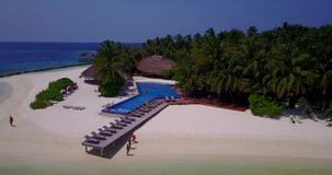 V06696 Aerial flying drone view of Maldives white sandy beach swimming pool in luxury 5 star resort hotel relaxing Stock Images