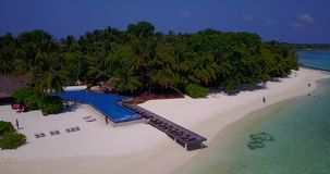 V06683 Aerial flying drone view of Maldives white sandy beach swimming pool in luxury 5 star resort hotel relaxing Stock Photo