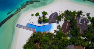 V06733 Aerial flying drone view of Maldives white sandy beach swimming pool in luxury 5 star resort hotel relaxing Royalty Free Stock Images