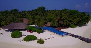 V06700 Aerial flying drone view of Maldives white sandy beach swimming pool in luxury 5 star resort hotel relaxing. Aerial flying drone view of Maldives white stock video footage