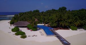 V06747 Aerial flying drone view of Maldives white sandy beach swimming pool in luxury 5 star resort hotel relaxing stock video footage