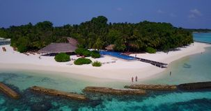 V06665 Aerial flying drone view of Maldives white sandy beach swimming pool in luxury 5 star resort hotel relaxing stock footage