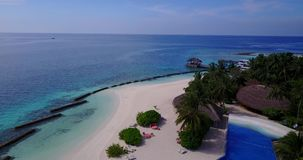 V06729 Aerial flying drone view of Maldives white sandy beach swimming pool in luxury 5 star resort hotel relaxing stock footage