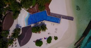 V06702 Aerial flying drone view of Maldives white sandy beach swimming pool in luxury 5 star resort hotel relaxing stock video