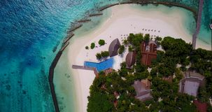 V06685 Aerial flying drone view of Maldives white sandy beach swimming pool in luxury 5 star resort hotel relaxing stock video footage