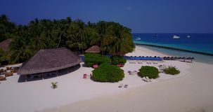 V06746 Aerial flying drone view of Maldives white sandy beach swimming pool in luxury 5 star resort hotel relaxing stock video footage