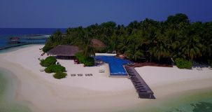 V06704 Aerial flying drone view of Maldives white sandy beach swimming pool in luxury 5 star resort hotel relaxing stock video footage