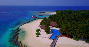 V06681 Aerial flying drone view of Maldives white sandy beach swimming pool in luxury 5 star resort hotel relaxing stock video