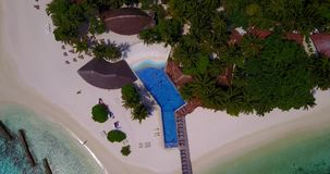 V06680 Aerial flying drone view of Maldives white sandy beach swimming pool in luxury 5 star resort hotel relaxing stock video
